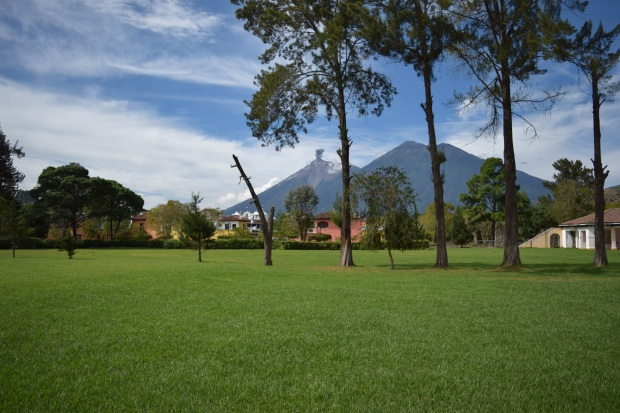 Fuego awakens in the background at the former home of Guatemalan cricket